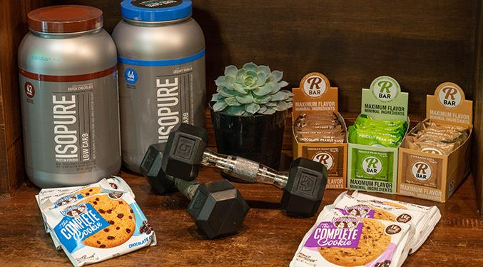 Supplements, waters, healthy snacks, Kombucha and more are available in the Lobby.